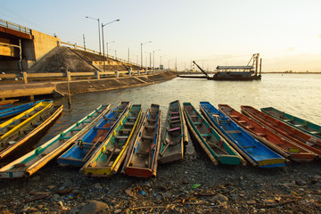 Philippines, Ilocos Region, Pangasinan, Dagupan, Colorful boats by water's edge