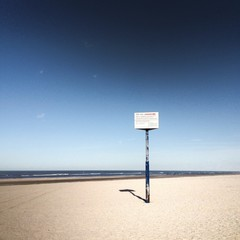 Lonely sign on beach