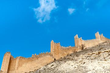 Spain, Aragon, Teruel Province, Albarracin, Fortified wall against blue sky
