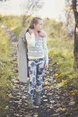 Iceland, Girl standing on path in park