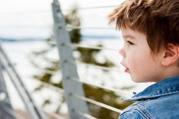 Boy (2-3) looking away