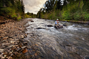 USA, Colorado, Hinsdale County, Lake City, Angler choosing new fly