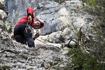 Italy, Speleo, Man climbing on rock