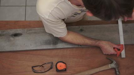 Industrial Carpenter Marking Wood Overhead