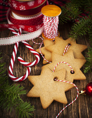 Christmas decoration and gingerbread cookies on wooden table