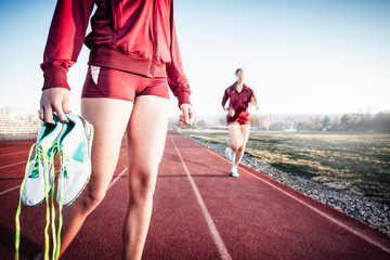 USA, Colorado, Two women on running track