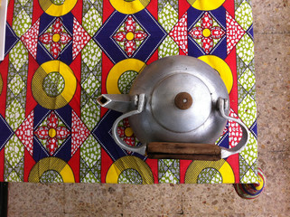 Portugal, Lisbon, Teapot on colorful printed tablecloth