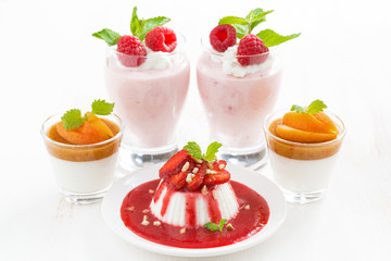 assortment of desserts with cream jelly and fresh berries