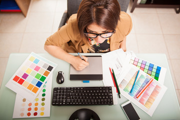 Graphic designer in her office