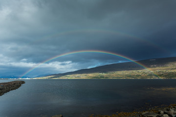 Iceland, Akureyri, Double rainbow over Eyjafjordur fjord