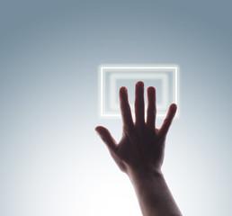 Studio shot of man's hand touching digital touch screen buttons