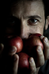Italy, Lombardy, Milan, Man is holding apples with his hands