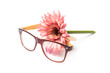 glasses and bunch of flowers on a white background