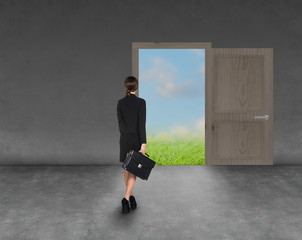 Composite image of businesswoman walking away