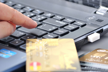 finger to button beside credit card, shopping online payment