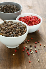 Peppercorns assorted in bowls