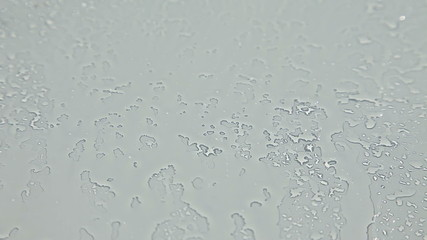 Spraying water on windshield glass