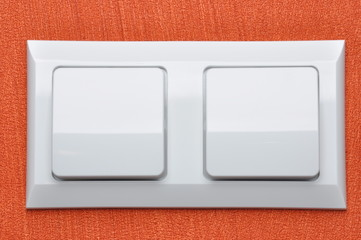 Double white light switch on red wall