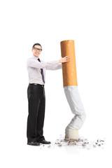Handsome man putting out a huge cigarette