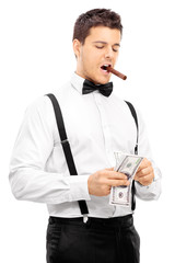 Guy with cigar in his mouth counting money