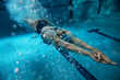 Female swimmer at the swimming pool.Underwater photo. - 77446323