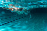 Male swimmer at the swimming pool.Underwater photo.