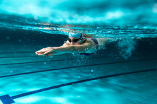 "Постер, картина, фотообои ""Female swimmer at the swimming pool.Underwater photo."""