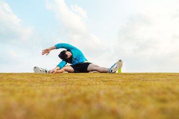 sportsman doing warming and stretching exercise