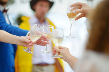 People holding wine glasses at festive event