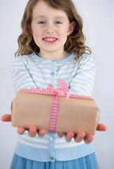 girl giving present