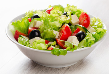 Fresh vegetables salad with feta, olives .