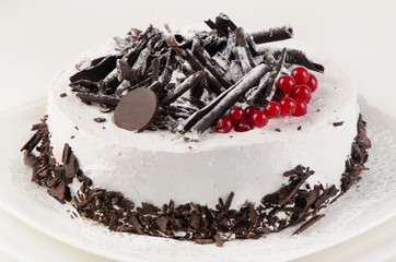 White cream  cake with  currant and chocolate