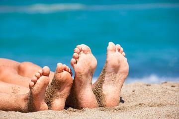 Feet on a beach