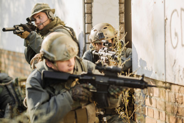 Soldiers With Rifles Patrolling During War