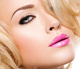 Portrait of fashion model with bright pink lips and black makeu