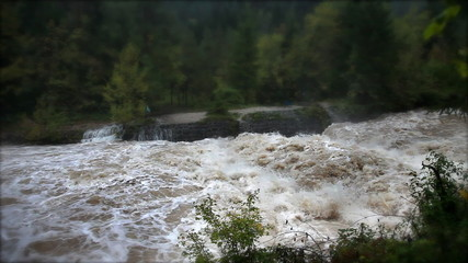 View of the rapids on the increased muddy river