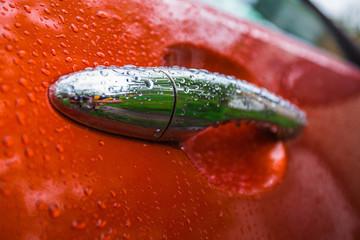 Handle orange car is wet