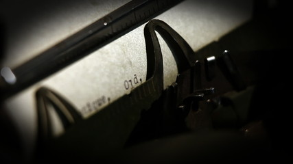 Close up of a typewriter's details when typing and text