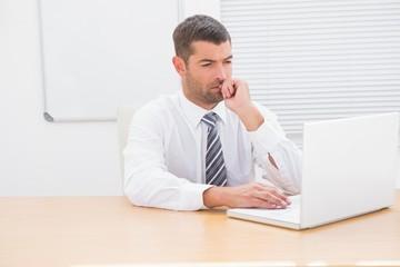 A businessman working at desk