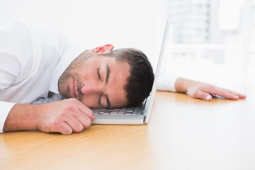 Businessman sleeping in his computer