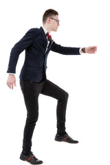 Full length side view of businessman climbing imaginary steps ag