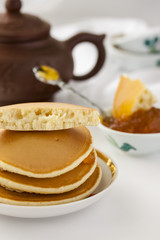 pancakes with delicious jam on white plate