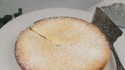 Slicing a baked apple pie and removing the slice