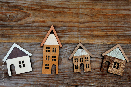 house on wooden background - 77456109
