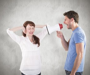 Composite image of man shouting through a megaphone