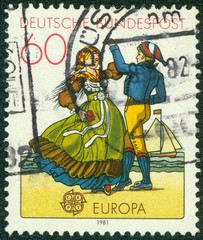 stamp shows North German couple dancing in regional costumes