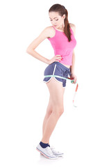 Happy slim woman measuring her waist!