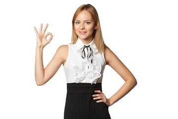 Young teen female showing gesturing OK against white background!