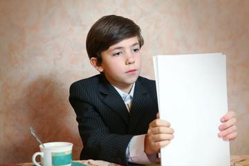 school boy in businessman suit