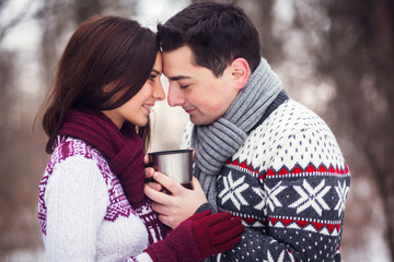 Portrait of a loving couple with a cup of tea outdoors